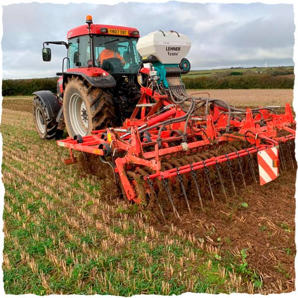 Tractor with direct drill in field